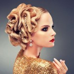 Mmodel in a Golden dress with a fashionable hairstyle